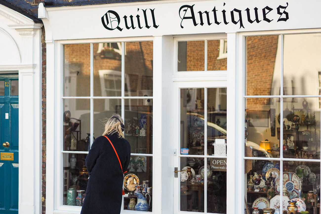 Alexandra Stedman looking through the shop window at Quill Antiques in Deal, Kent.