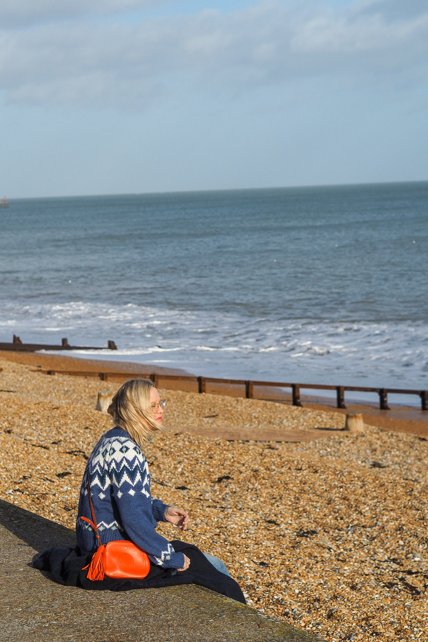 Alexandra Stedman of The Frugality sat at Deal's pebbly beach.