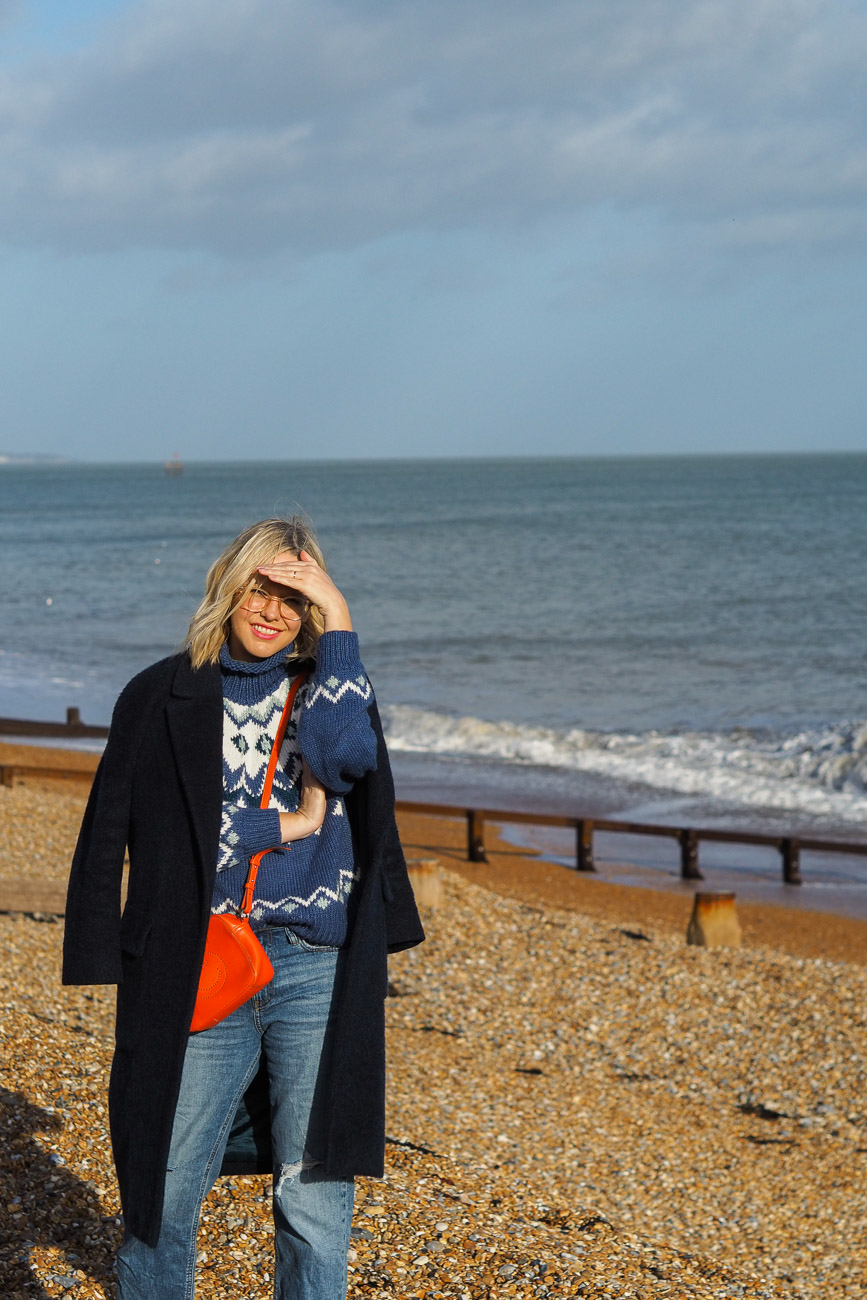 Alexandra Stedman of The Frugality walking along Deal's pebbly beach.