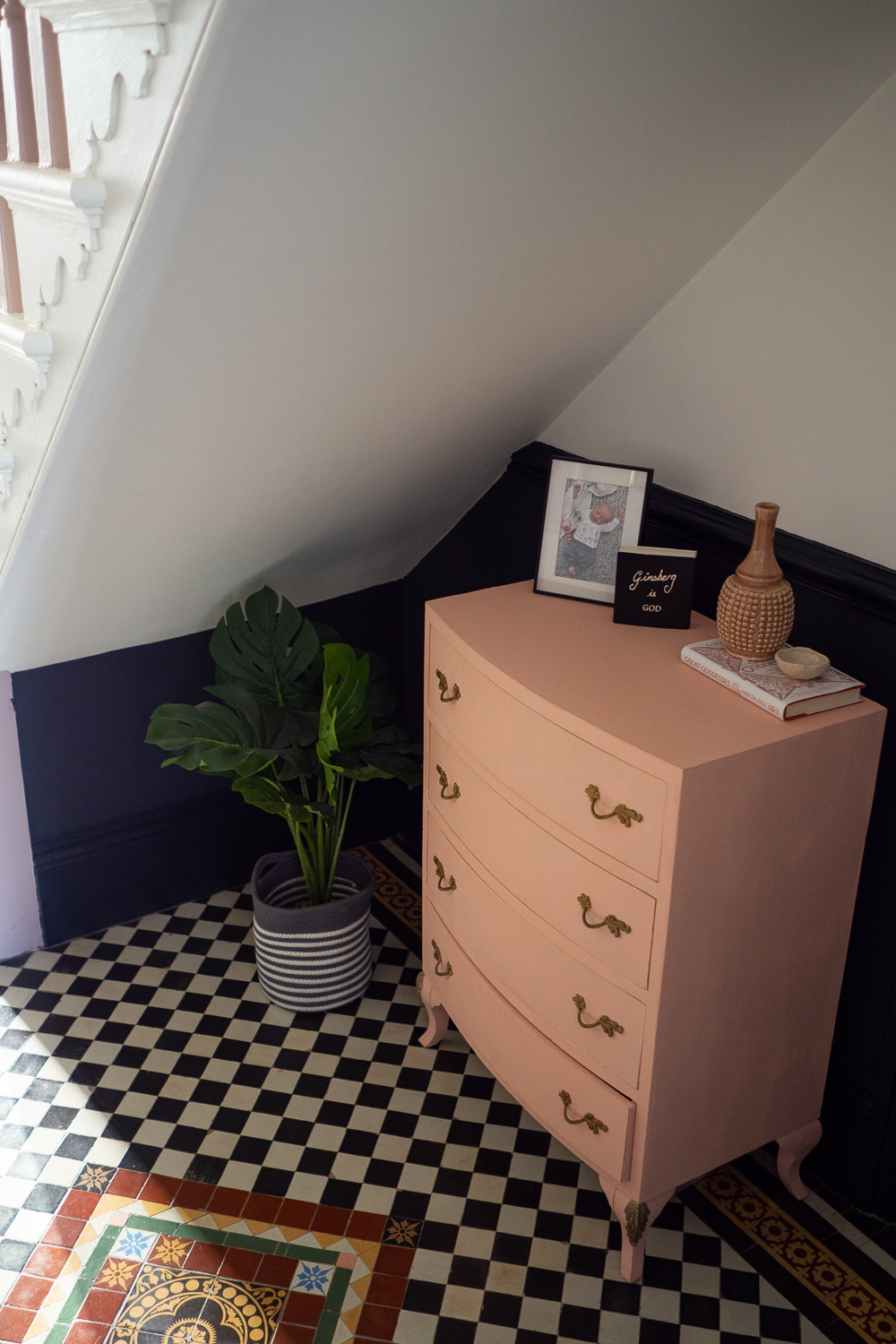 Under the stair case where an old up-cycled repainted cabinet now lives.