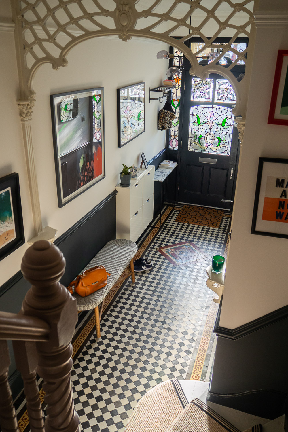 A view of The Frugality's Hallway Tiles and front door from the staircase.