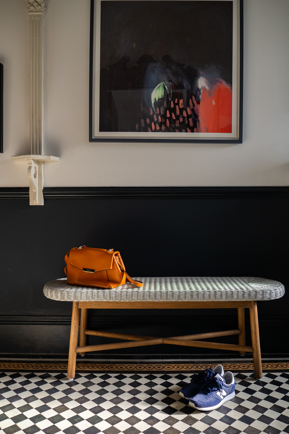 House of Frasier bench in The Frugality's hallway. Styled with a pair of New Balance trainers and Sandro leather bag.