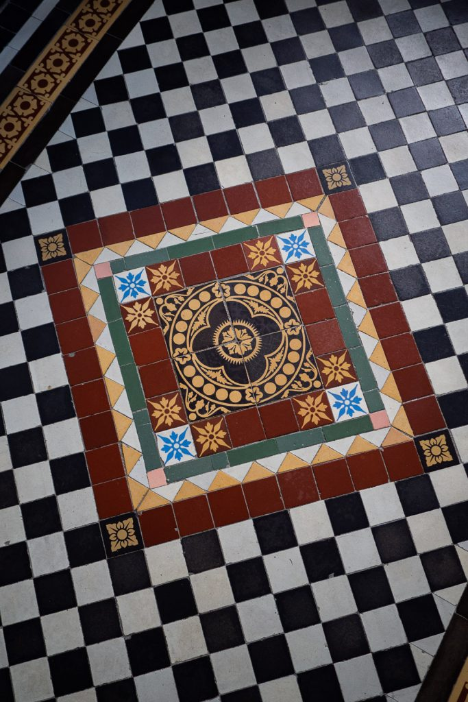 The Edwardian emblem on the floor tiles of The Frugality hallway. These are the original tiles that came with the house.