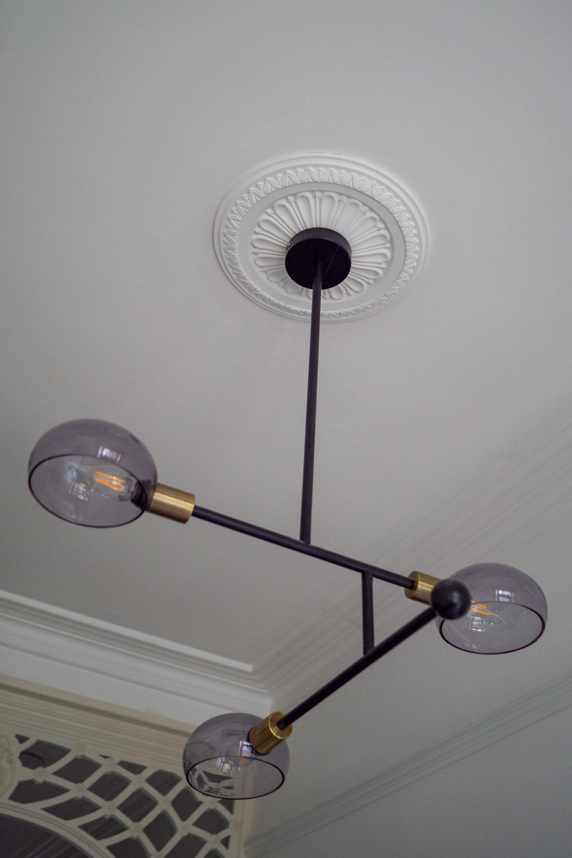 Made dot com three pronged light and WM Boyle ceiling rose.