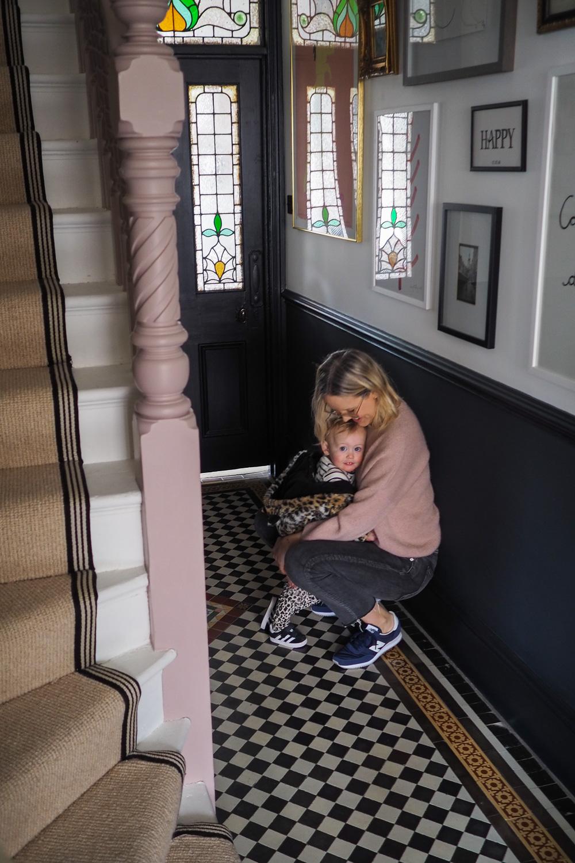 Alex Stedman hugging her daughter in their hallway.