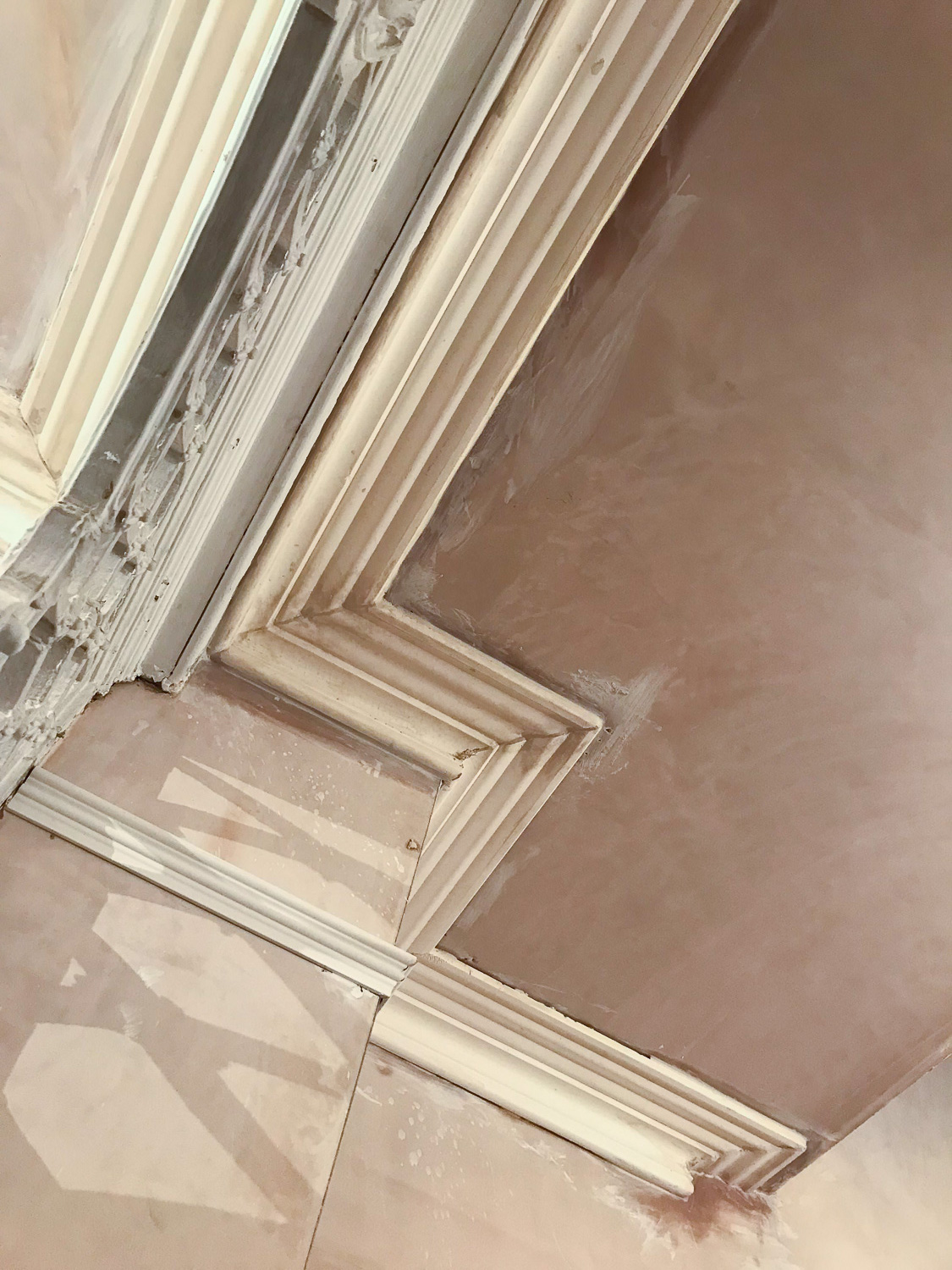 Detailed close up of the coving just after it had been fitted and before it had been painted.