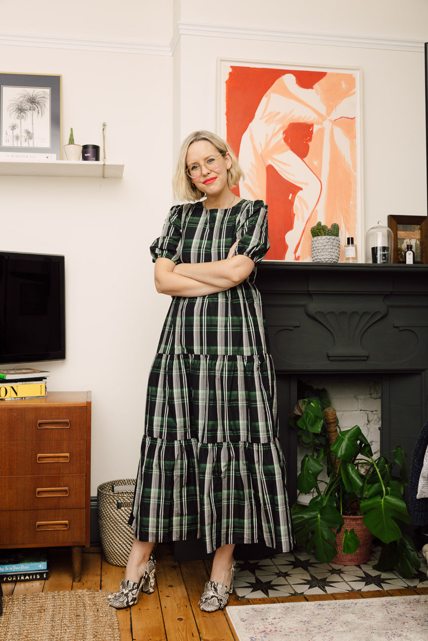Alex Stedman of The Frugality wearing a green and white checked dress from Topshop.