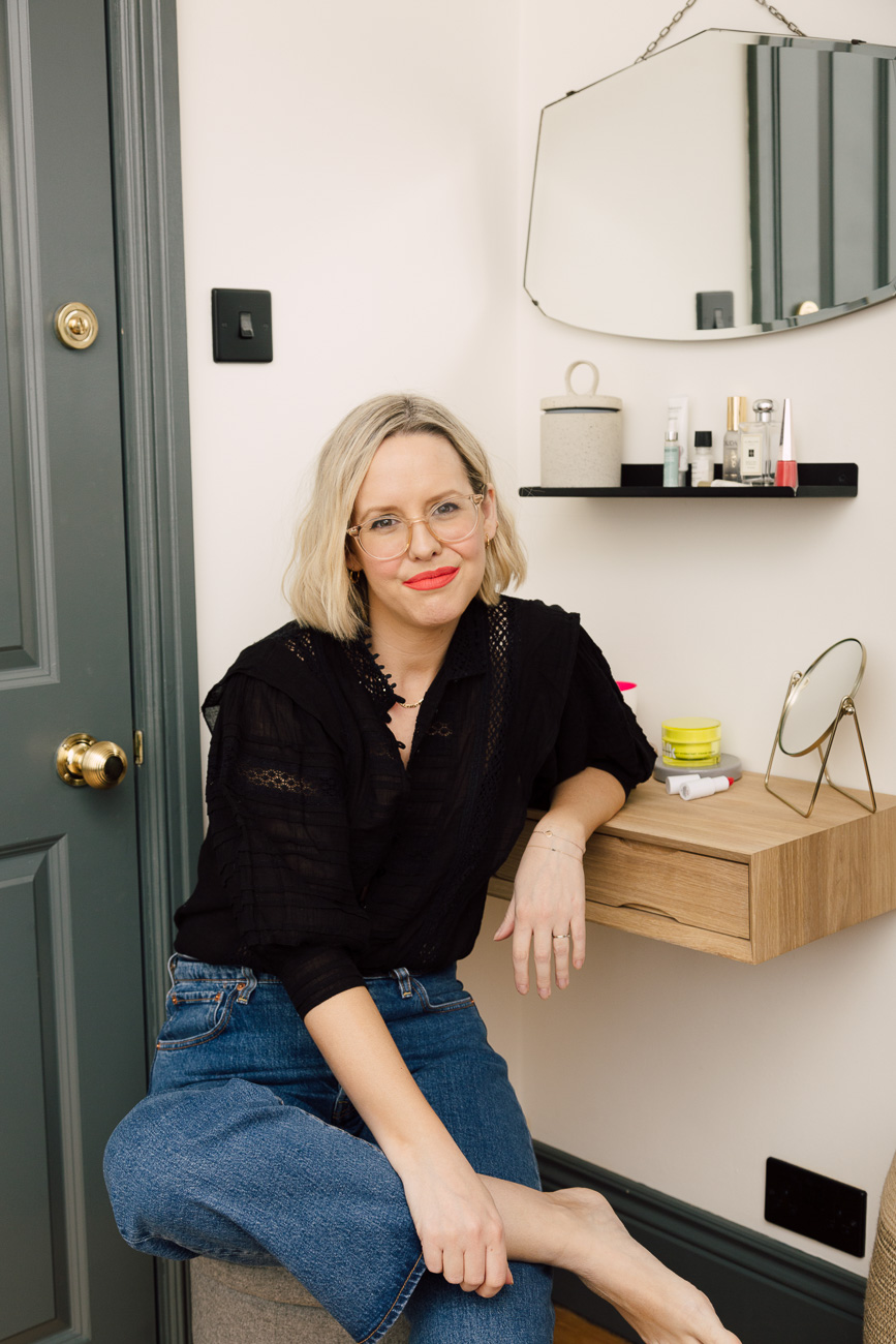 Alexandra Stedman of The Frugality sat at her dresser table wearing the 'Unattached' Stunna lip paint by Fenty Beauty.