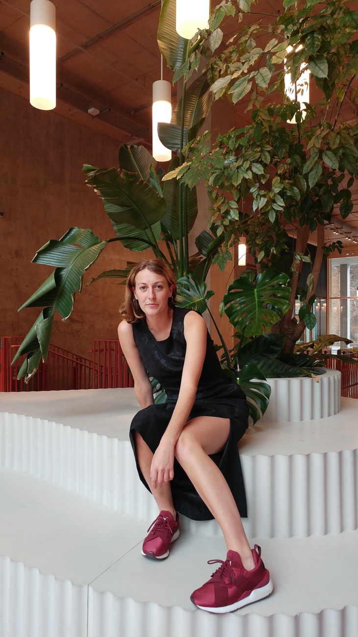 Hattie from Boutique by Shelter, Kings Cross, is wearing a vintage Eastex dress and Puma trainers.